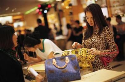 Shopping in Louis Vuitton store, downtown Shanghai, 07 September 2012.  Reuters/Carlos Barria